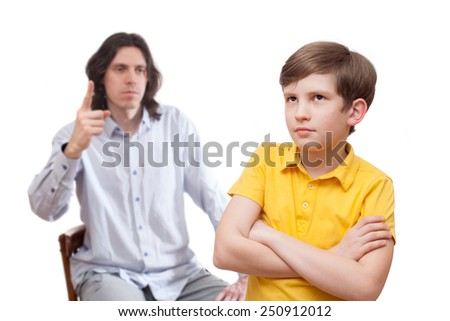 The conflict between father and his son, isolated on white background - stock photo