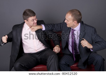The conflict between two young business men - stock photo