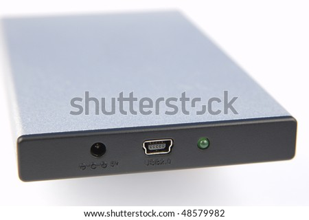 The connections on a portable USB hard drive - stock photo