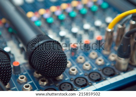 The connectors are connected to the audio mixer and microphone sound recordist - stock photo