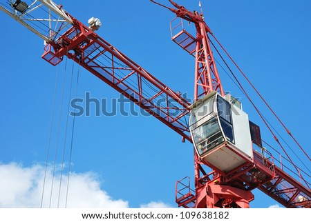 The construction crane on day - stock photo