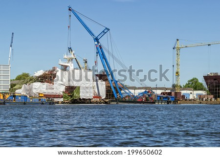 The construction of the hull of the ship in the shipyard - stock photo