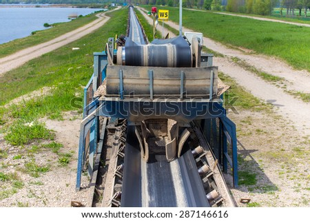 The conveyor of the sand at the sand mine - stock photo