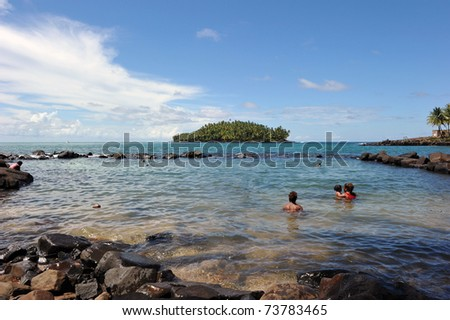 The convicts' pool of Isle Royale, French Guiana. In the background, Devil's island. Long ago a French prison, now those islands are a tourist attraction and station for the Guiana Space centre. - stock photo
