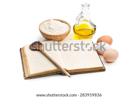 the cookbook and ingredients for preparing pasta - stock photo