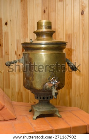 the copper samovar costs on bricks and waits when it boil