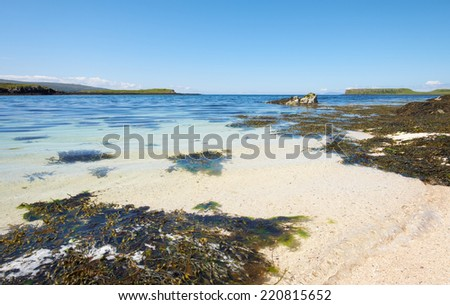 The Coral Beaches on the shores of Loch Dunvegan near Claigan with the island of Lampay just offshore. - stock photo