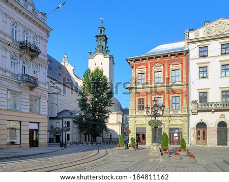 The corner of Rynok Square and view of Latin Cathedral in Lviv, Ukraine - stock photo