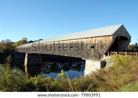 The Cornish-Windsor Covered Bridge spans the Connecticut River connecting the towns of Cornish, NH and Windsor, VT - stock photo