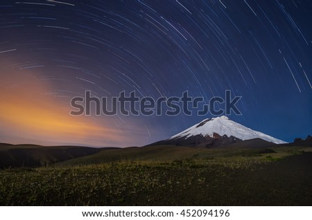 The Cotopaxi volcano in Ecuador, night shot with star trails - stock photo