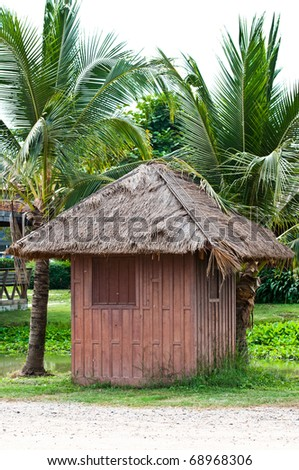 The Cottage under Coconut tree - stock photo