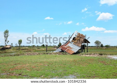The cottage was destroyed in the storm the field. - stock photo