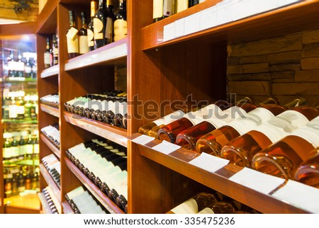 the counter at the supermarket with alcoholic beverages - stock photo