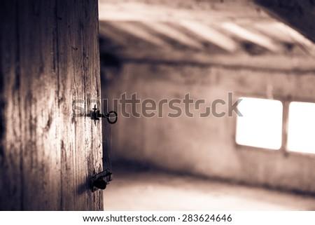 The country house attic door - stock photo