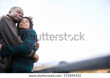 the couple hugging