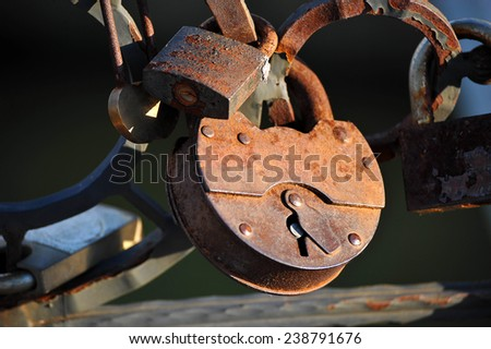 The couple hung a lock on the bridge railing - stock photo