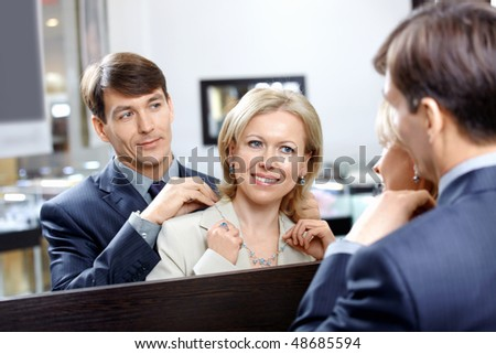 The couple is elderly at a mirror in shop - stock photo