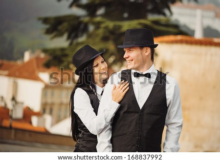 The couple of gangsters are  in a street - stock photo