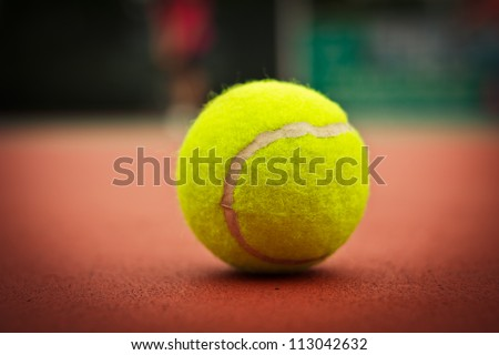 The court, a tennis ball closeup,