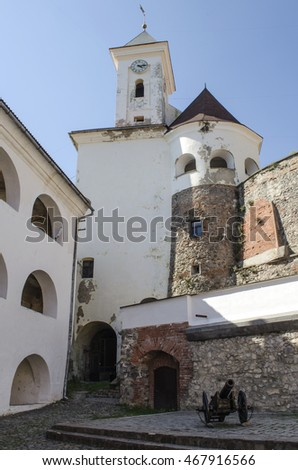 The courtyard and clock tower of the ancient castle Palanok in Mukachevo, Ukraine