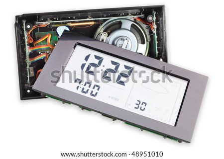 The cracked disassembled broken digital electronic clock with the big display. Isolated on white. Contains clock and display clipping patches. Mass production. - stock photo