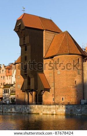 The Crane (Polish: Zuraw), a famous landmark in the Old Town of Gdansk (Danzig) at the Motlawa river in Poland, sunset time - stock photo