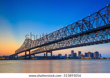 The Crescent City Connection Bridge on the Mississippi river and downtown New Orleans Louisiana