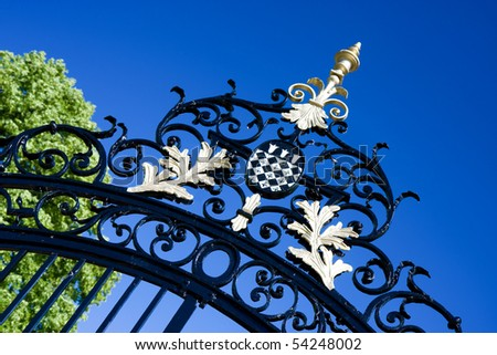 The crest of Magdalen College, Oxford on an iron gate - stock photo