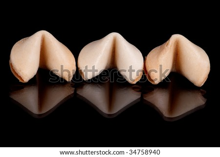 The crispy Fortune cookie image on black background - stock photo