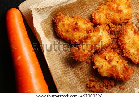 The crispy fried prawn and carrot represent the vegetable and food ingredient background concept related idea.
