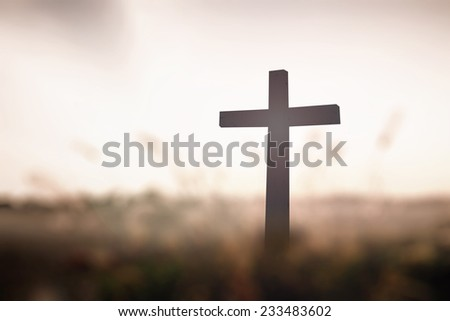 The cross on blurred sunset background. Thanksgiving, Christmas background, Worship, Forgiveness, Mercy, Humble, Repentance, Reconcile, Adoration, Glorify concept. - stock photo