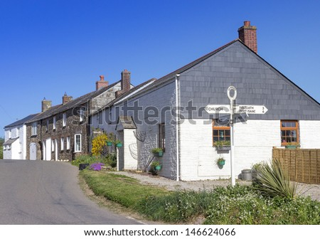 The crossroads and signpost in the picturesque, quiet village of St. Minver, Cornwall in the south-west of England. Copyspace available. - stock photo