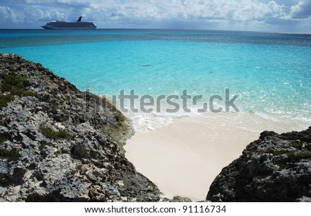 The cruise liner arrived to Half Moon Cay, small tropical island of The Bahamas. - stock photo