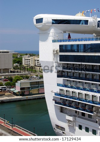 The cruise liner's back with San Juan downtown in a background (Puerto Rico). - stock photo