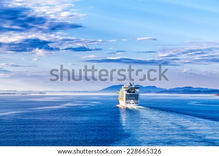 The cruise white liner sailing on the sea - stock photo