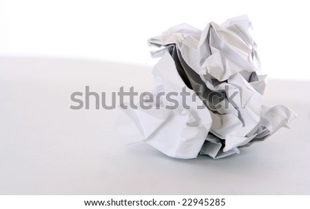 The crumpled paper in a lump against a white background