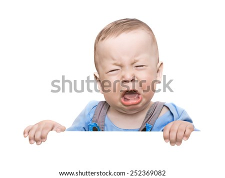 The crying boy, on  white background, with empty place for your text - stock photo