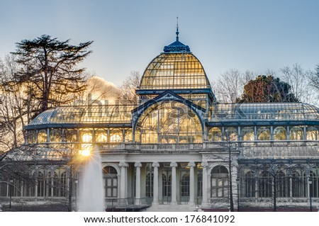 The Crystal Palace (Palacio de Cristal), a glass and metal structure built by Ricardo Velazquez Bosco in 1887 to exhibit flora and fauna from the Philippines on Buen Retiro Park in Madrid, Spain. - stock photo
