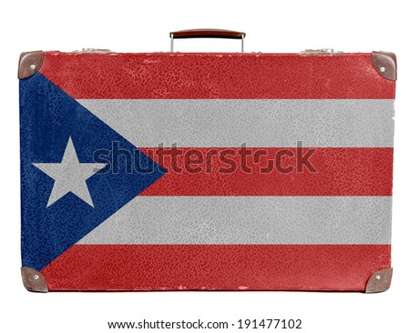 The Cuban flag painted on old grungy travel suitcase or trunk  - stock photo
