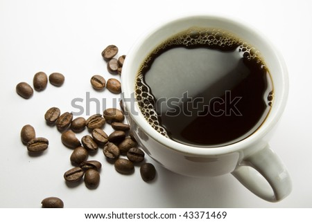 The cup of coffee and beans, isolated on white background. - stock photo