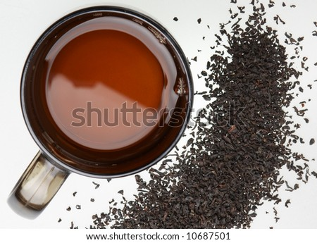 The cup of tea and tea leaves - stock photo