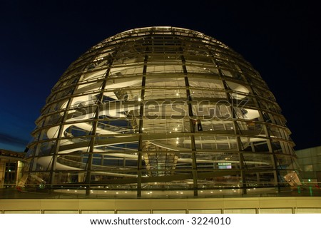 The Cupola on top of the Reichstag building in Berlin, Germany, illuminated by Night - stock photo
