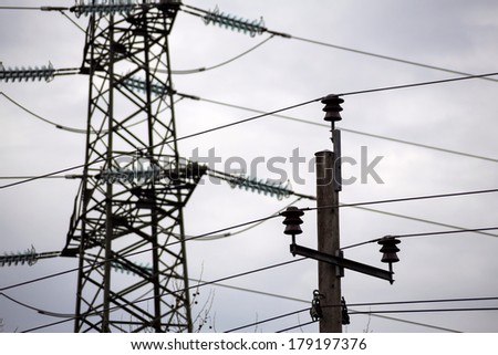 the current mast of a high voltage transmission line to carry electricity and energy. - stock photo