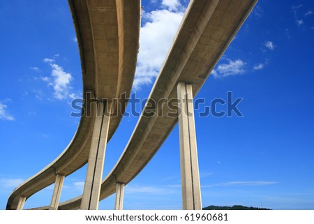 The curve of suspension bridge on blue sky. - stock photo