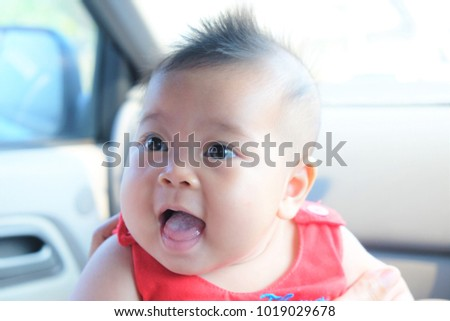 Cute baby girl smiling happily her stock photo edit now shutterstock the cute baby girl is smiling happily in her mothers arms hundreds of smiling little voltagebd Choice Image