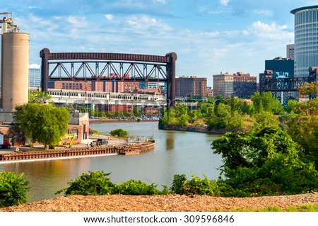 The Cuyahoga winds through an industrial section of the Flats in downtown Cleveland, Ohio - stock photo