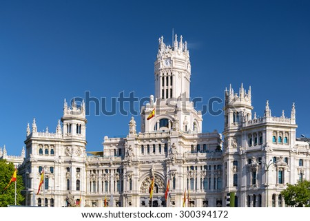 The Cybele Palace (Palacio de Cibeles) or the Palace of Communication in Madrid, Spain. Blue sky in background. Madrid is a popular tourist destination of Europe. - stock photo