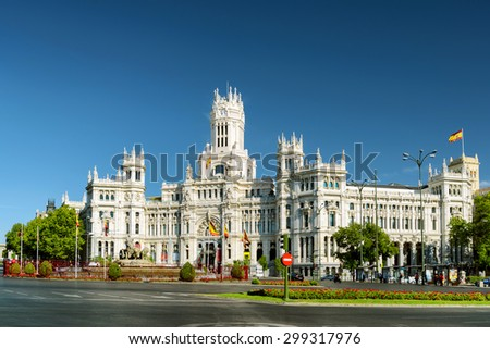 The Cybele Palace (Palacio de Cibeles) or the Palace of Communication on the Cybeles Square (Plaza de Cibeles), Madrid, Spain. Madrid is a popular tourist destination of Europe. - stock photo