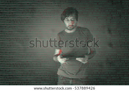 The cyber criminal, person using a tablet in deep web cyberspace. Glitched style photo.
