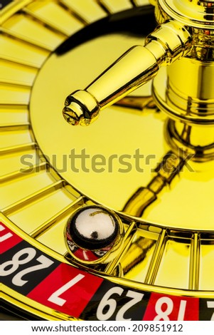 the cylinder of a roulette gambling in a casino. winning or losing is decided by chance. - stock photo